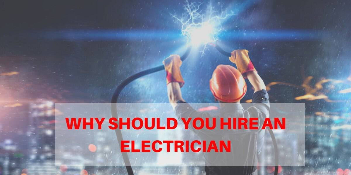 electrician holding electrical wire